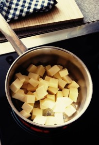 Butter diced into cubes in a pan